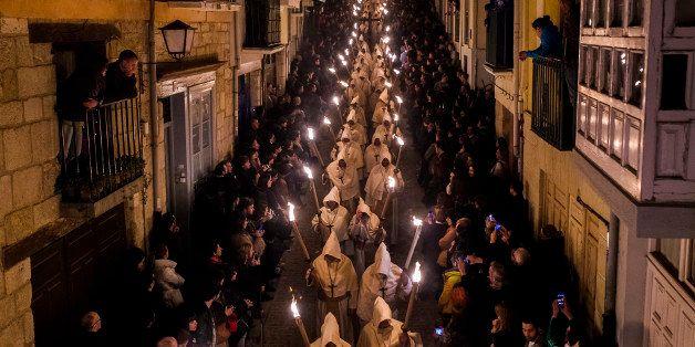 Penitents from 'Cristo de la Buena Muerte' or 'Good Dead Christ' brotherhood take part in a procession in Zamora, Spain, earl