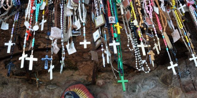 CHIMAYO, NM - NOVEMBER 10, 2012: Rosary beads, scapulars and other Christian sacramentals left by visitors to the Santuario d