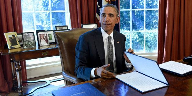 President Barack Obama speaks in the Oval Office of the White House in Washington, Tuesday, March 31, 2015, after signing a M