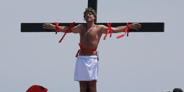 Danish national Lasse Spang Olsen, a 48-year-old filmmaker, stays nailed to a cross to re-enact the crucifixion of Jesus Chri