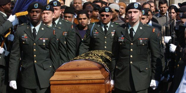 The casket of Army Spc. Azhar Ali is carried by the Color Guard after a prayer services at the Masjid Al-Mamoor Jamaica Musli