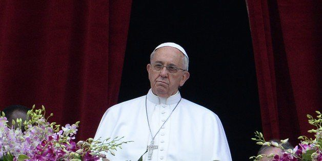 Pope Francis stands at the central loggia of St Peters' basilica during the 'Urbi et Orbi' blessing for Rome and the world fo
