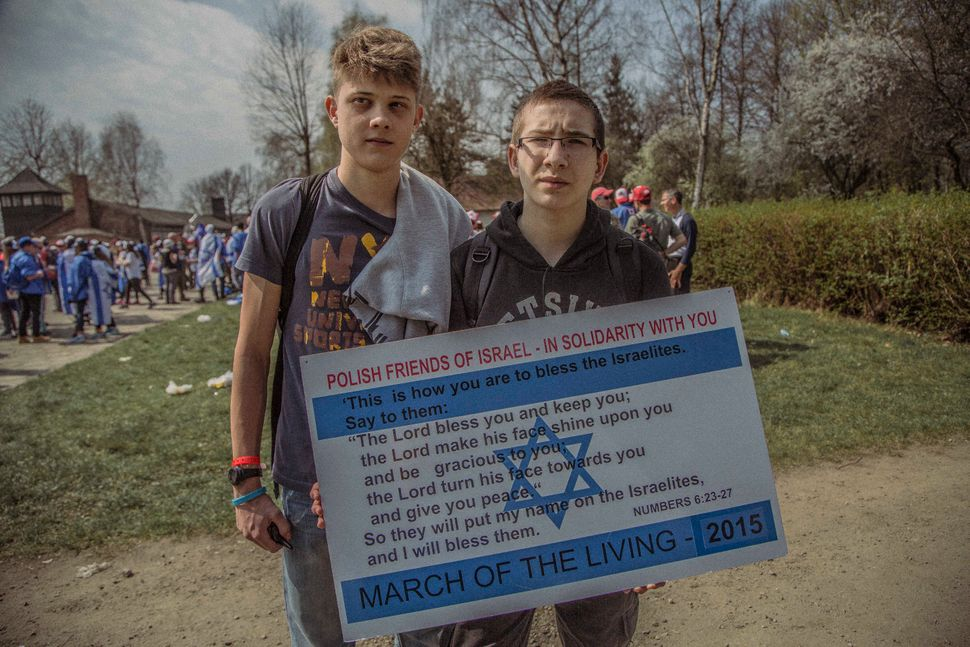 Two 14-year-old local boys, Wojtek Josse and Pawel Mitoraj, attend the march to show their support.