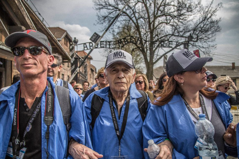 Holocaust survivor Max Eisen marches through the famed gates of Auschwitz where he pays tribute to his parents, siblings and