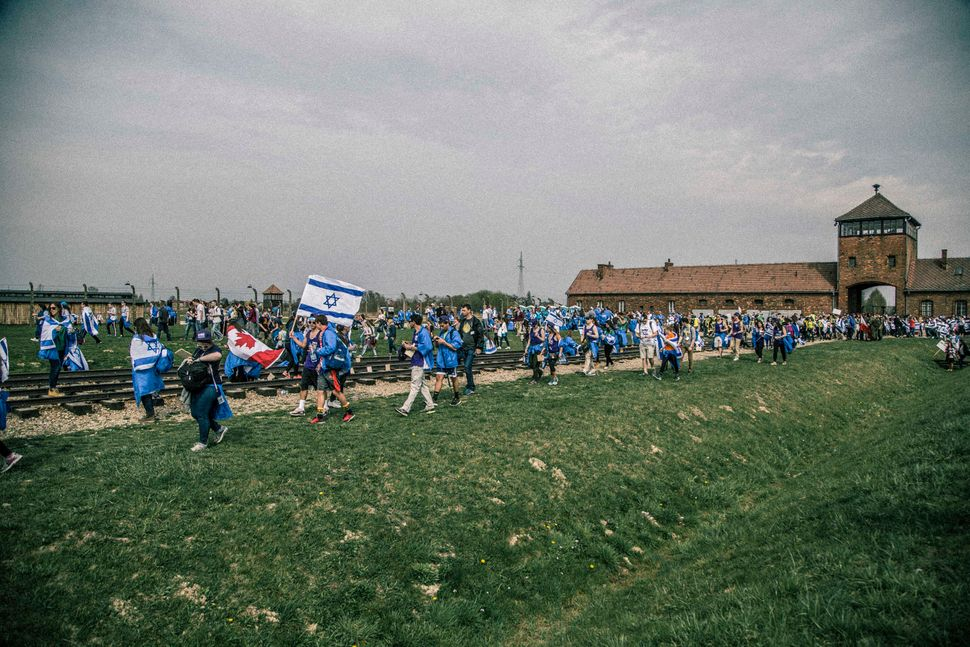 The marchers enter the Birkenau death camp where they pay tribute to the millions killed in the Holocaust.