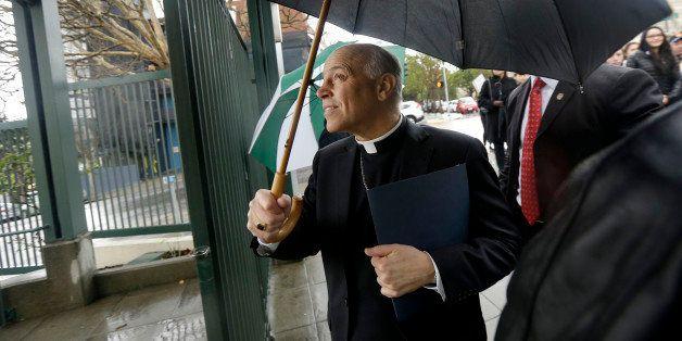 Salvatore Cordileone, the Roman Catholic archbishop of San Francisco, walks through a gate to Sacred Heart Cathedral Preparat