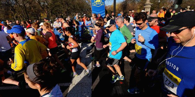 BOSTON, MA - APRIL 18:  The first wave of runners takes off from the starting line during the B.A.A. 5k on April 18, 2015 in