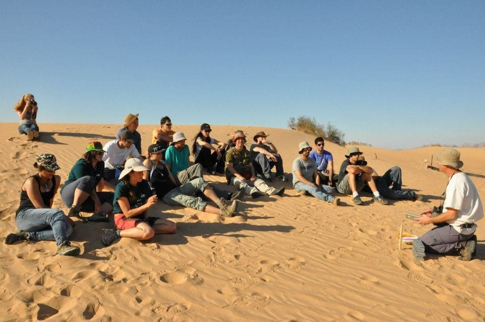 Arava students listen to a lecture from a faculty member.