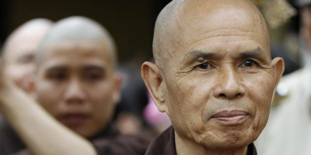 Ho Chi Minh City, VIET NAM: CORRECTION Zen Buddhist leader Thich Nhat Hanh (R) walks during a procession at the opening of a