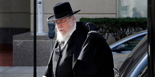 Rabbi Mendel Epstein, 69, arrives at federal court as the jury deliberations continue into the third day in his case Tuesday,