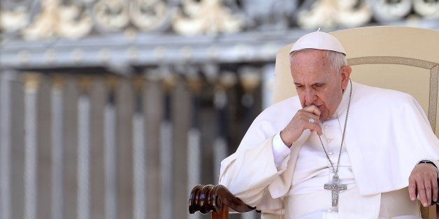 Pope Francis gestures as he attends the weekly general audience in St Peter's square at the Vatican on April 22, 2015.    AFP