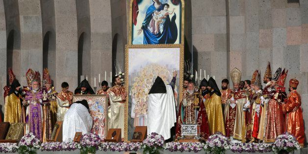 Armenian Church priests bless the icon with in Echmiadzin, the religious center of the Armenian Church outside the capital Ye