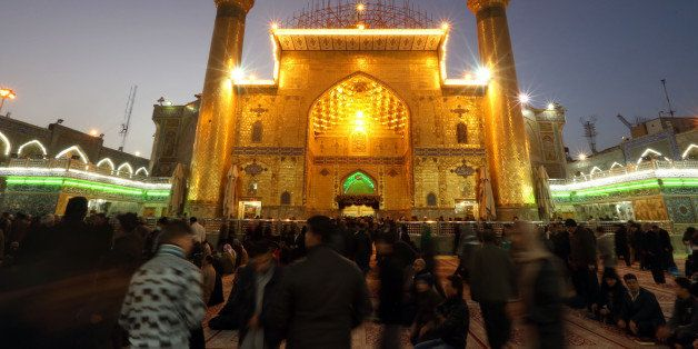 In this Thursday, Jan. 8, 2015 photo, Shiite faithful pilgrims pray at the holy shrine of Imam Ali in the Shiite holy city of