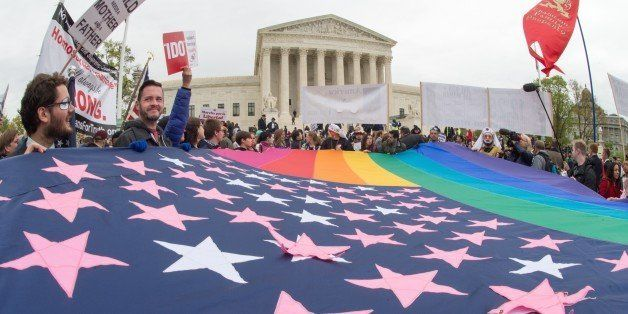 Protesters hold a pro-gay rights flag outside the US Supreme Court on April 25, 2015, countering the demonstrators who attend