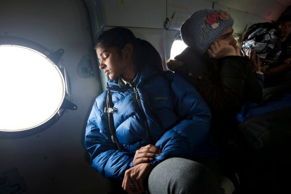 Indian trekker Rabbi Sangbi and other trekkers fly back to Kathmandu on an Indian Air Force helicopter after being rescued in