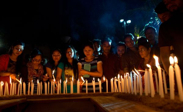 Indians light candles and offer prayers for victims of Nepal's Saturday earthquake, in Gauhati, India, Thursday, April 30,