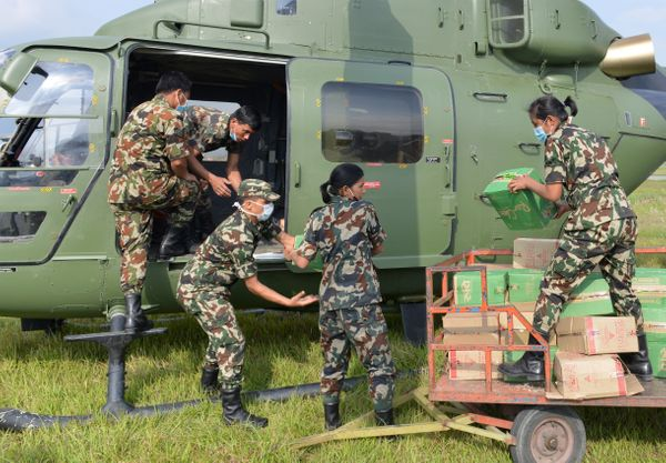 Nepalese Army personnel unload relief aid at the airport in Kathmandu on April 30, 2015. The UN launched an appeal for Nepale