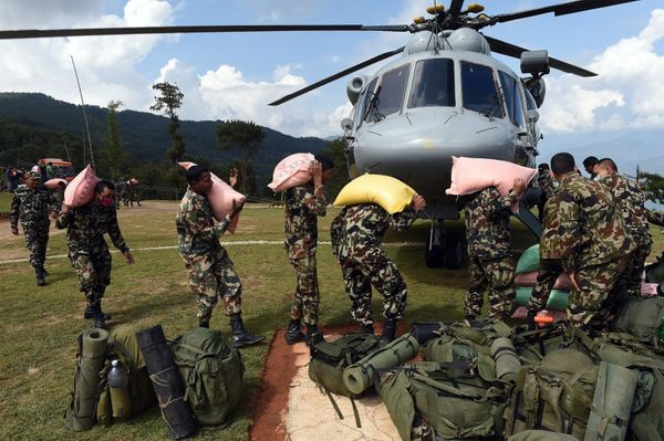 Nepal Armed Force personnel load relief aid at Charikot, in Dholka district on April 30, 2015.  The UN launched an appeal for