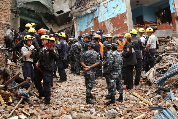 KATHMANDU, NEPAL - APRIL 30: US rescue team and Nepal military prepare to pull out fifteen old Pemba Lama from rubble of dest