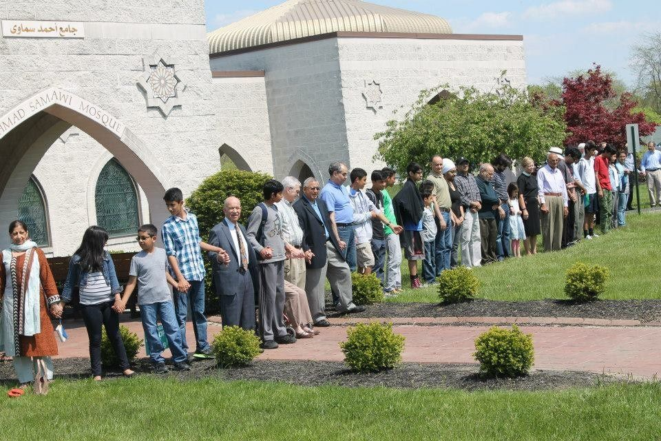 """Community members gather at the Islamic Center of Greater Cincinnati to form a """"peace ring."""""""