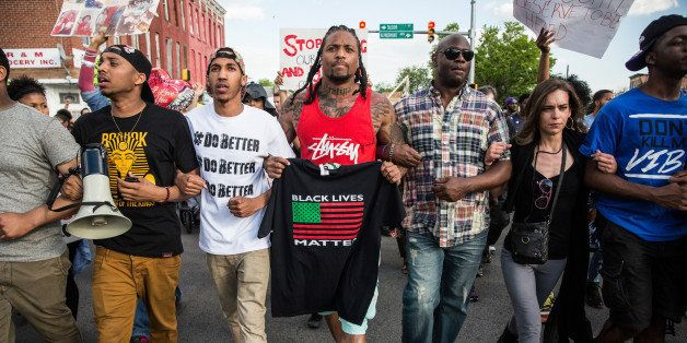 BALTIMORE, MD - MAY 02: Protesters march from City hall to the Sandtown neighborhood May 2, 2015 in Baltimore, Maryland. Fred