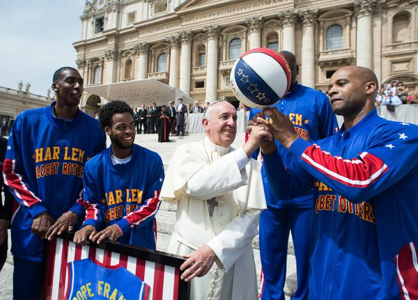 Harlem Globetrotters' Hi-Lite Bruton, left, Ant Atitkson, second from left, Big Easy Lofton, second from right, look at teamm
