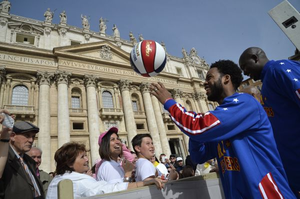 Members of the Harlem Globetrotters basketball play with a ball before the arrival of Pope Francis for his weekly general aud