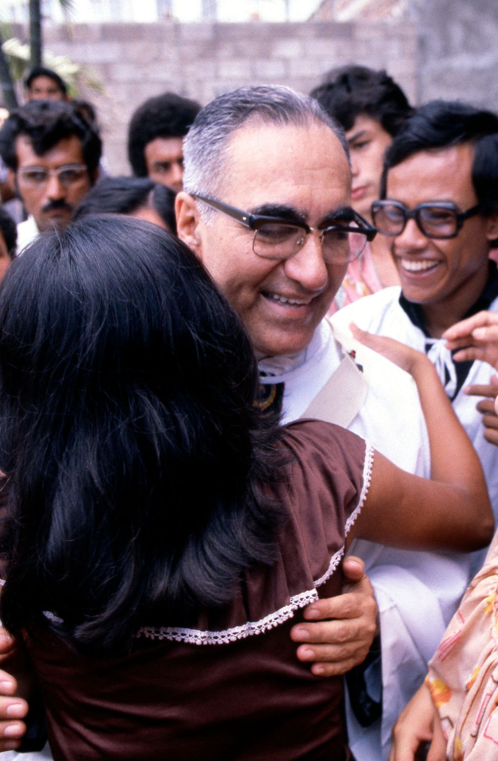 Jan 1, 1979 - San Salvador, El Salvador - EXCLUSIVE - The martyr Archbishop Oscar Romero of El Salvador is hugged by a parish