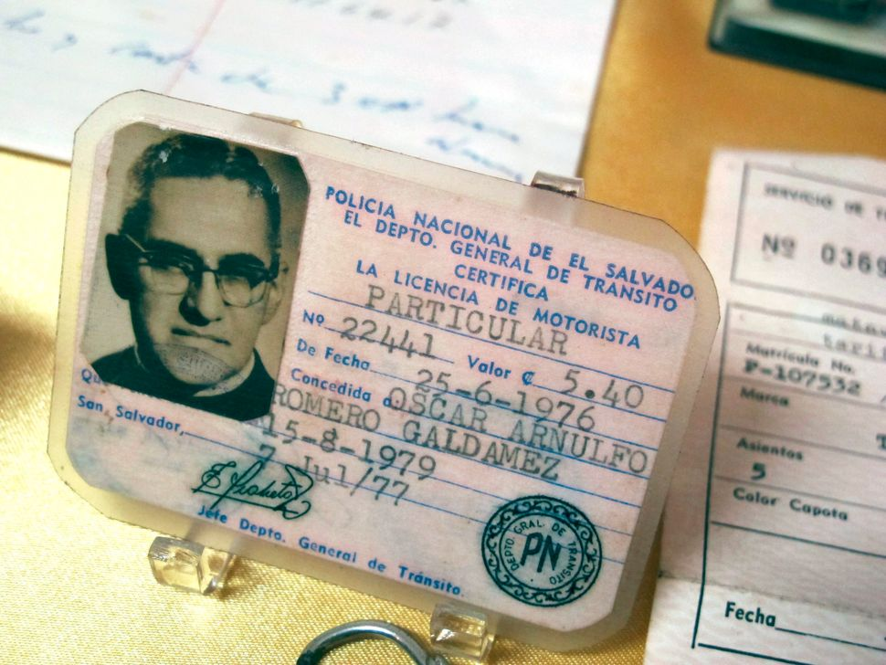 Artifacts - including a driver's license -belonging to the martyr Archbishop Oscar Romero on display in the priests residence