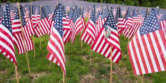 This garden of 37,000 flags was planted in honor of every fallen Massachusetts service member from the Revolutionary war tp t