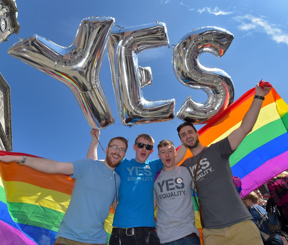 Supporters in favour of same-sex marriage pose for a photograph as thousands gather in Dublin Castle square awaiting the refe