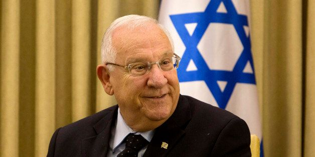 Israel's President Reuven Rivlin, smiles during his meeting with German Foreign Minister Frank-Walter Steinmeier at the Presi