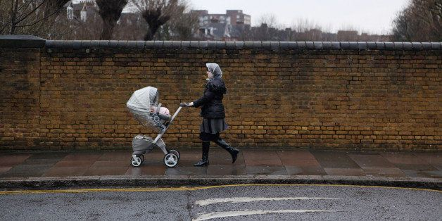 LONDON, ENGLAND - JANUARY 12:  A woman pushes a pram in the Stamford Hill area of north London on January 12, 2011 in London,