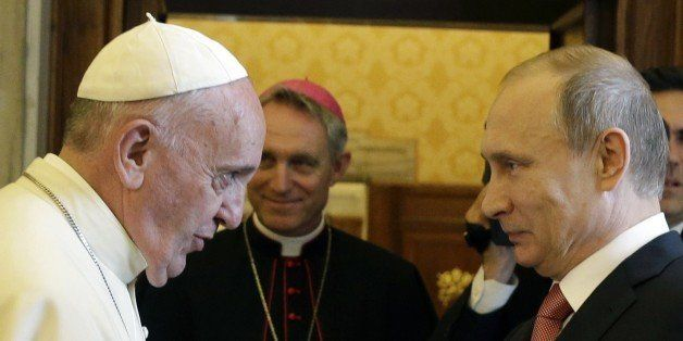 Pope Francis (L) meets with Russian President Vladimir Putin on the occasion of a private audience at the Vatican, on June 10
