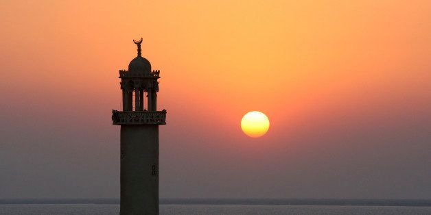 In this Sunday, Dec. 12, 2010 photo, a minaret of mosque, at sunset in the Laaft village of the Qeshm island, which lies at t