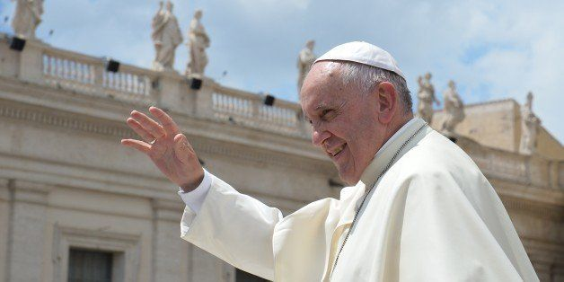 Pope Francis greets the crowd at the end of his weekly general audience at St Peter's square on June 17, 2015 at the Vatican.