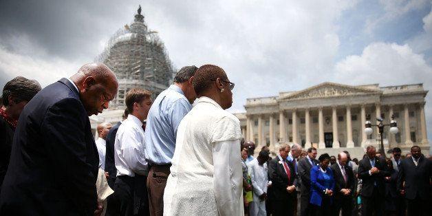 WASHINGTON, DC - JUNE 18: Rep. John Lewis (D-GA) (L) joins members of the US House of Representatives and members of the US S