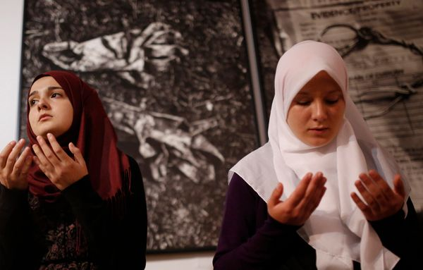 Bosnian Muslims offer a prayer during late night prayer for upcoming holy month of Ramadan, inside memorial room for Srebreni