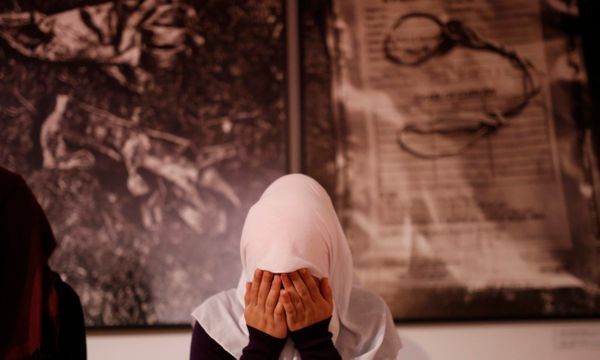 A Bosnian Muslim woman offers a prayer during late night prayer for upcoming holy month of Ramadan, inside memorial room for