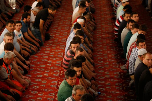 Muslims pray in the iconic Sultan Ahmed Mosque, better known as the Blue Mosque, in the historic Sultanahmet district of Ista