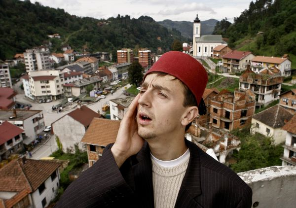 FILE - In this Monday, Oct. 3, 2005 file photo, Bosnian Muslim imam Idriz Halilovic, 23, calls noon prayer from atop the Whit