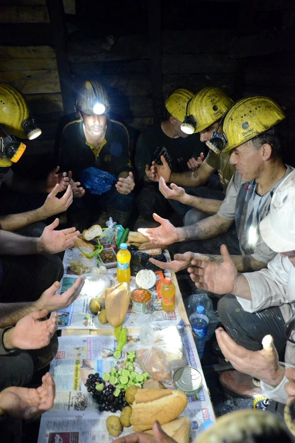 ZONGULDAK, TURKEY - JUNE 18: Coal miners pray before they eat this year's first 'Suhoor', the meal consumed early in the morn