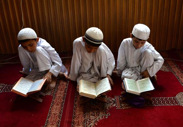 Afghan children study the Quran during first day of the month of Ramadan at a mosque in Jalalabad on June 18, 2015, Islam's h