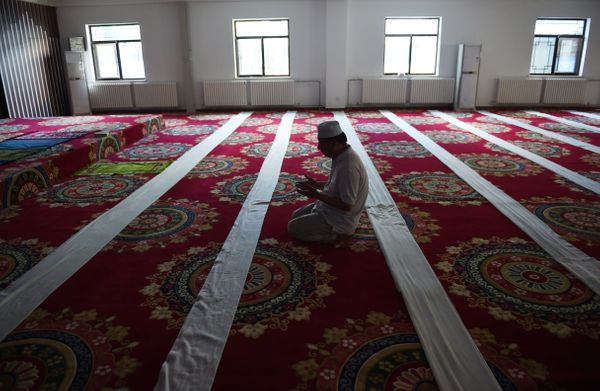 A Chinese Muslim offers prayers on the first day of Ramadan, the Muslim holy month, at a mosque in Beijing on June 18, 2015.