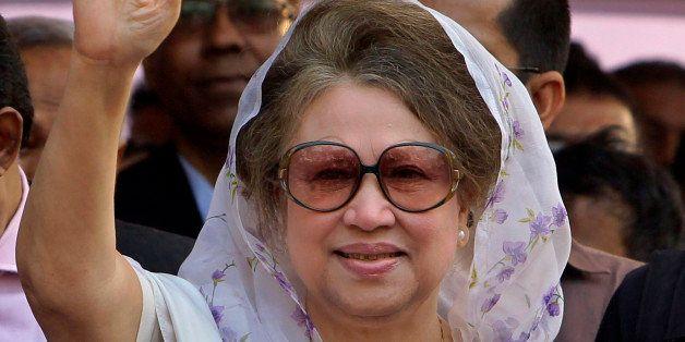 Bangladesh's former Prime Minister and opposition Bangladesh Nationalist Party (BNP) leader Khaleda Zia, waves as she arrives