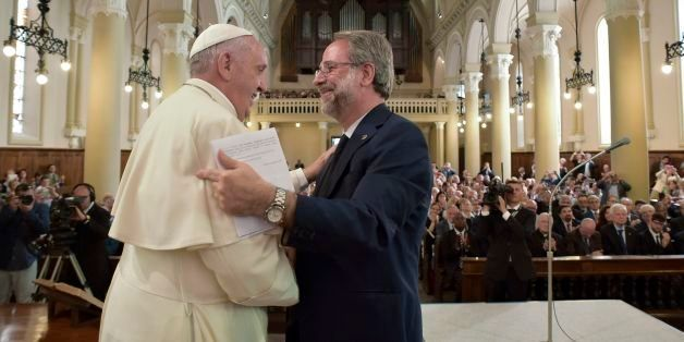 Pope Francis shakes hands with Eugenio Bernardini, the Moderator of the Waldensian Church, during the first ever visit of a p