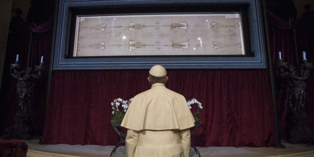 In this pool photo taken Sunday, June 21, 2015, and made available Monday, June 22, Pope Francis prays in front of the Holy S