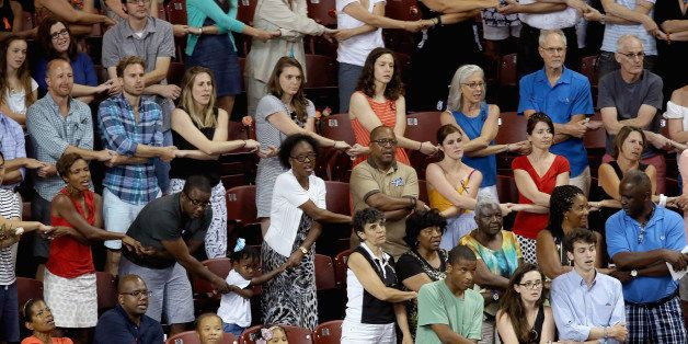 CHARLESTON, SC - JUNE 19:  Thousands of people hold hands and sing 'We Shall Overcome' during a prayer vigil for the nine vic