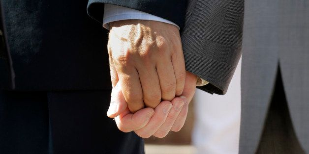 Texas marriage plaintiffs Vic Holmes, left, and partner Mark Phariss, right, hold hands on the steps of the Texas Capitol dur