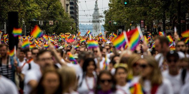 SAN FRANCISCO, CA- JUNE 28: San Francisco's Ferry Builiding is seen behind marchers in the San Francisco Gay Pride Parade, Ju